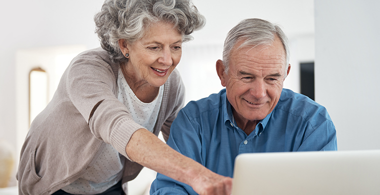Image of a couple looking at a computer screen